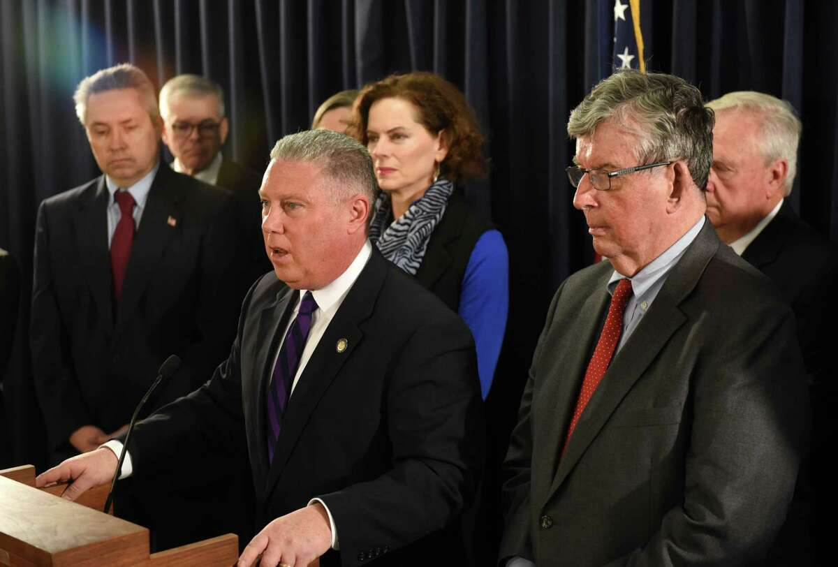 Assemblyman John T. McDonald III, center, is joined by Assembly member Patricia Fahy, and Sen. Neil Breslin, right, during a press conference to discuss legislation they are sponsoring to ban the incineration of PFAS firefighting foam on Monday, March 2, 2020, at Empire State Plaza in Albany, N.Y. PFAS PFAS compounds were being incinerated at the Norlite facility in Cohoes. The chemicals, perfluoroalkyls and polyfluoroalkyls are associated with health problems including thyroid disorders and cancer when ingested. (Will Waldron/Times Union)