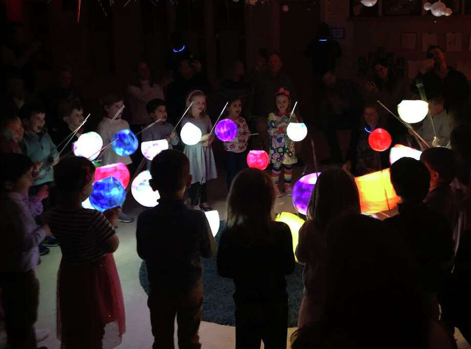 New Canaan Country School Beginners, students ages 4 and 5, participated in the school's annual Lantern Walk celebration recently with shadow puppet plays, songs and handmade lanterns. Photo: Contributed Photo