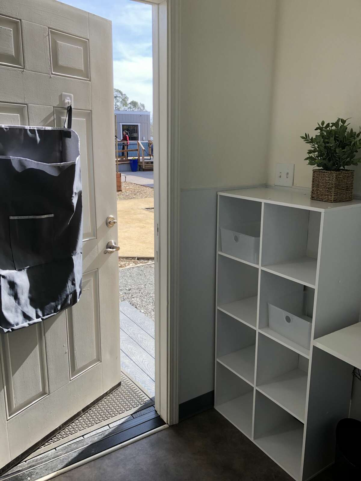 The model tiny home shown also has a shelving unit and small desk. The Bridge Housing Community in San Jose will provide temporary housing for 40 individuals.