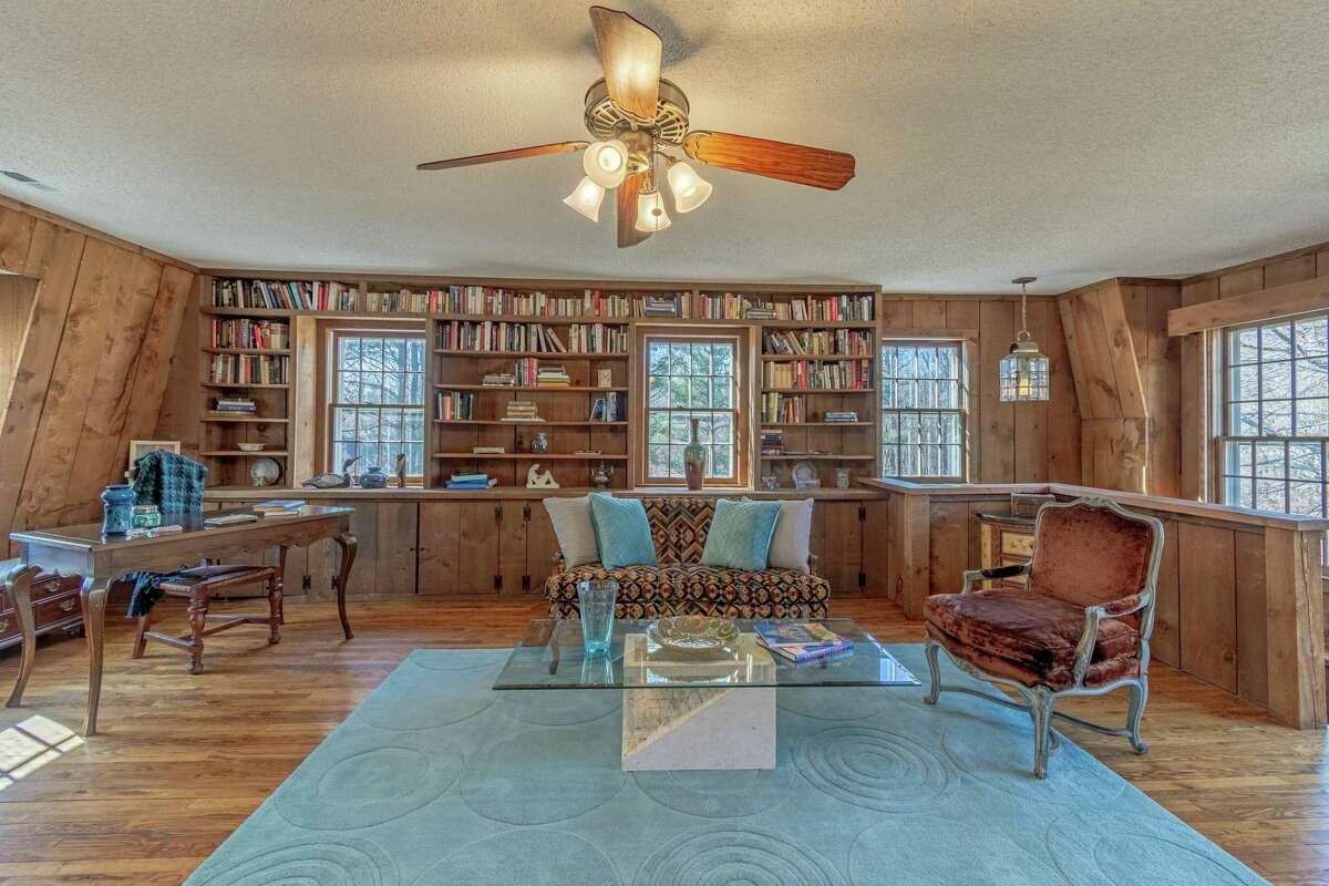 On the upper level there is a large flexible use room. It could serve as a family or game or playroom, a home office, library, or au-pair/in-law room. This room has a wall of built-in bookshelves.