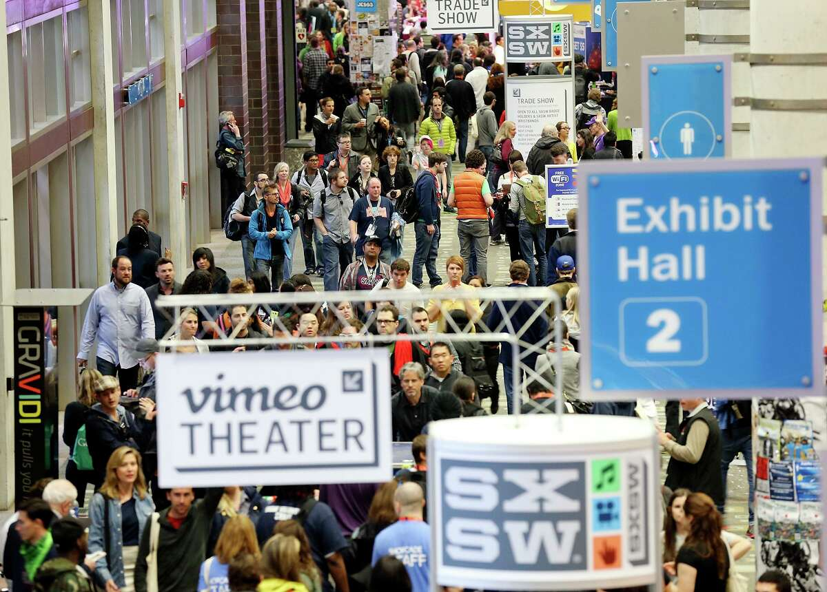 Crowds meander through the Austin Convention Center during South by Southwest Friday March 8, 2013 in Austin, TX.