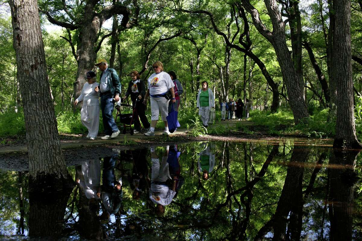 Participants walk on the path at Brackenridge Park for the Fun Walk at the opening ceremony at Texas State Senior Games Opening Ceremony in San Antonio in March 2012.
