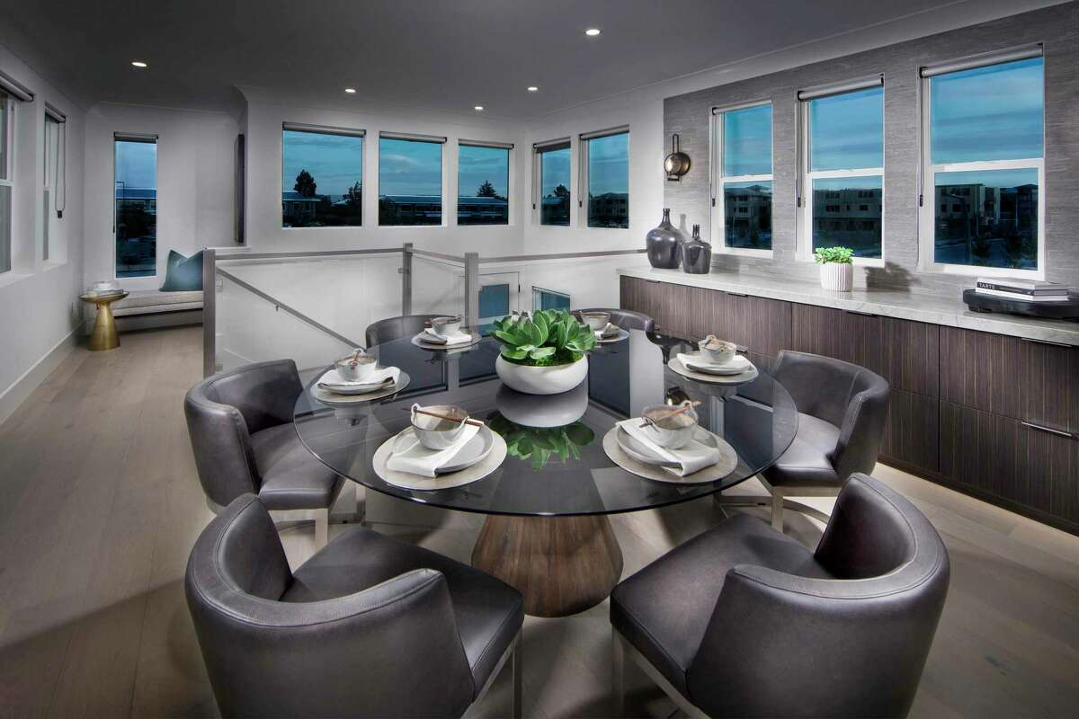 Picture windows flank the dining area of the