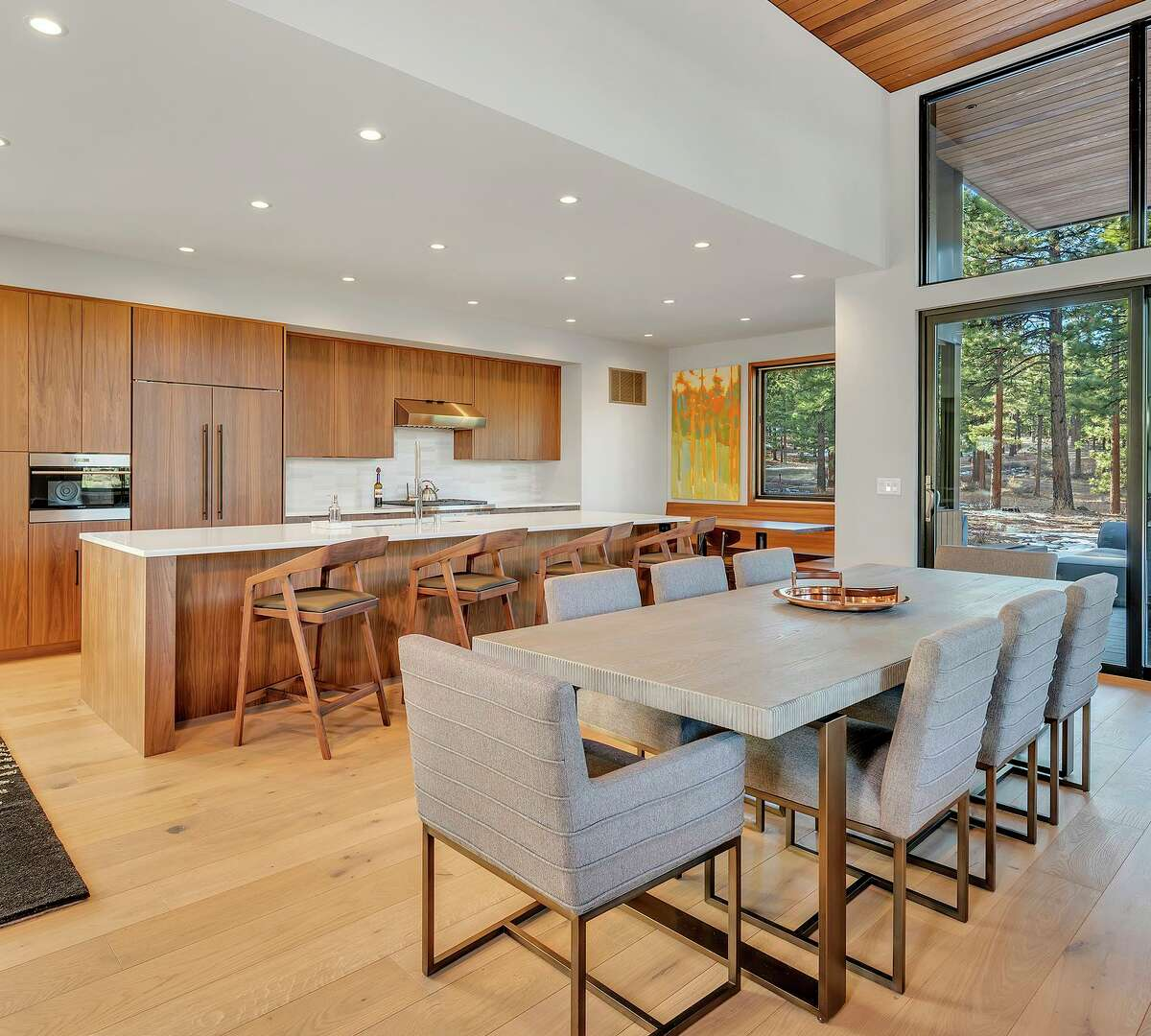An expansive island anchors an open kitchen equipped with professional appliances and custom cabinetry.
