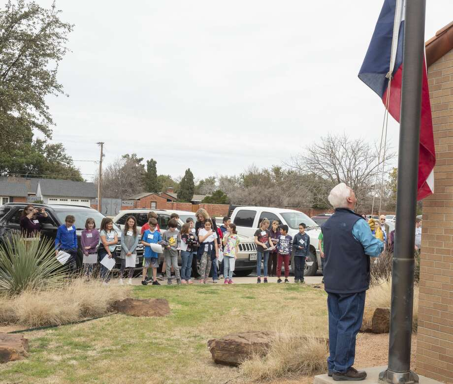 Pat McDaniel raises the Texas Flag 03/02/2020 outside the Haley Library during the Texas Independence Day celebration. Tim Fischer/Reporter-Telegram Photo: Tim Fischer/Midland Reporter-Telegram