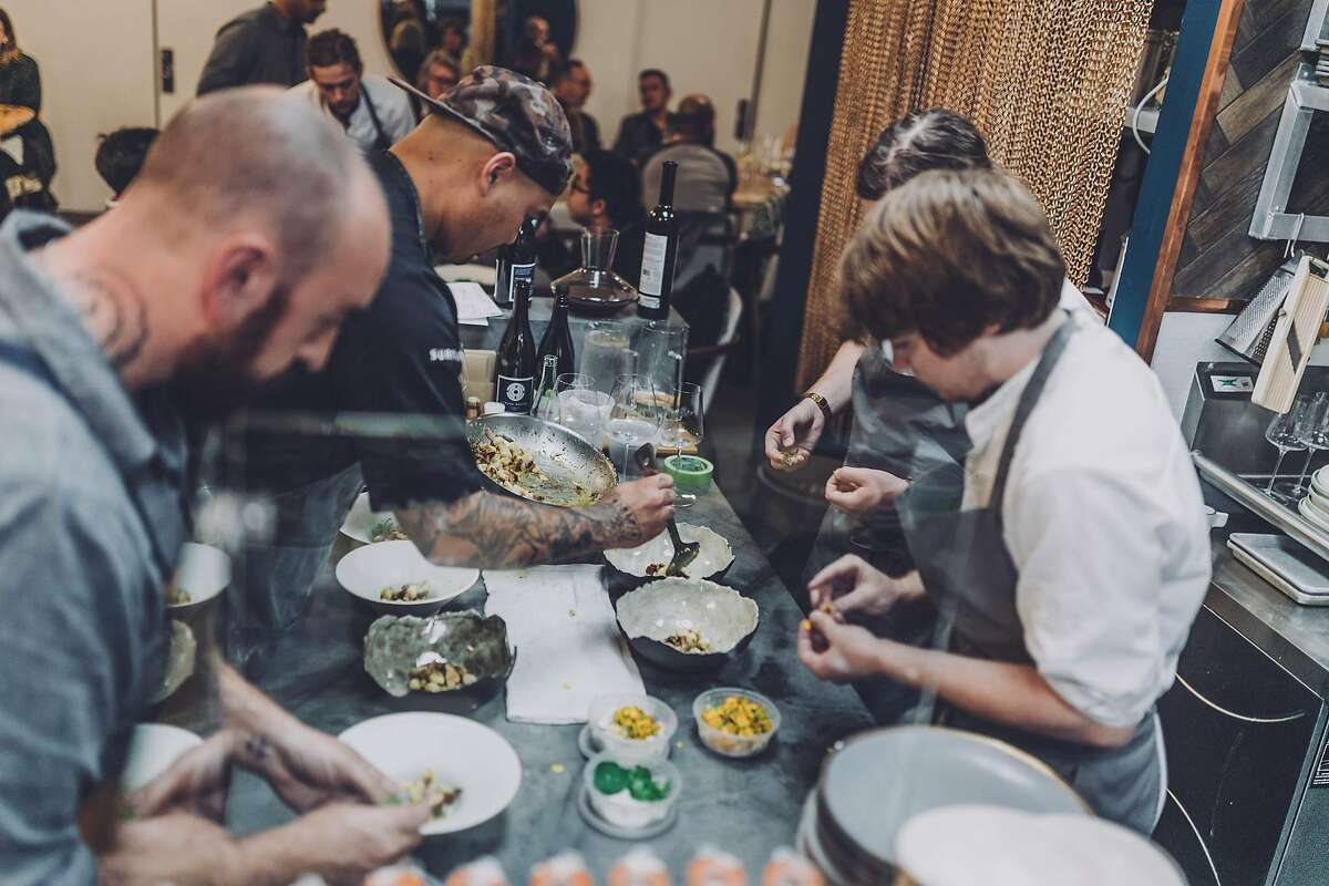 Merchant Roots chef-owner Ryan Shelton (left) plates a course with his team at his San Francisco restaurant.
