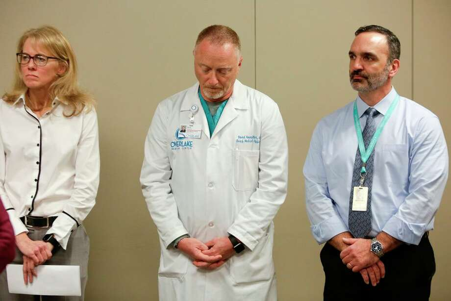 Kathy Lofy (L), Seattle Health Officer, Washington State Department of Health, David Knoepfler (C), Chief Medical Officer Overlake Medical Center and Ettore Palazzo of Evergreen Health listen to speakers  following the death of a a King County, Washington resident due to novel coronavirus (COVID-19) during a press conference in Seattle, Washington on February 29, 2020. - President Donald Trump urged Americans not to panic over  the novel coronavirus after the first death on US soil was confirmed, even as France ramped up its security measures by cancelling all mass gatherings. (Photo by Jason Redmond / AFP) Photo: JASON REDMOND, Getty / AFP or licensors