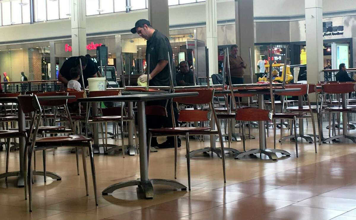 A North Star Mall employee cleans tables at the food court Monday morning. March 3, 2020. A person who tested positive for the coronavirus by state health officials visted the mall Saturday.