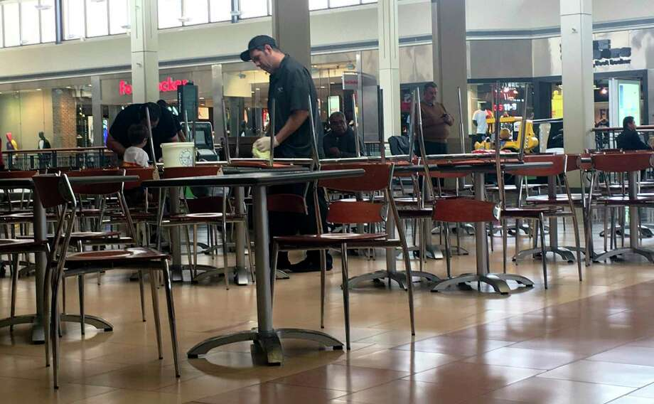 A North Star Mall employee cleans tables at the food court Monday morning. March 3, 2020. A person who tested positive for the coronavirus by state health officials visted the mall Saturday. Photo: Jerry Lara