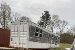 Officials unveiled this container that will become a housing unit for a local veteran.