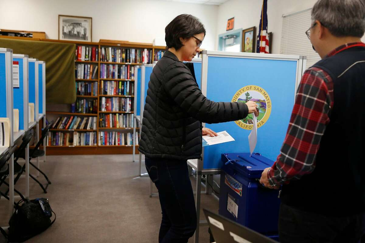 Sophia Cope of San Bruno places her ballot into the ballot box at the voting center at the San Bruno Senior Center on Monday, March 2, 2020 in San Bruno, Calif.