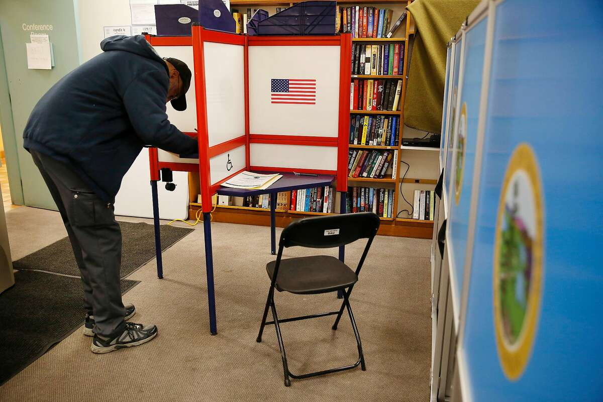 Aaron Jordan of San Bruno casts his ballot in a booth at the voting center at the San Bruno Senior Center on Monday, March 2, 2020 in San Bruno, Calif.