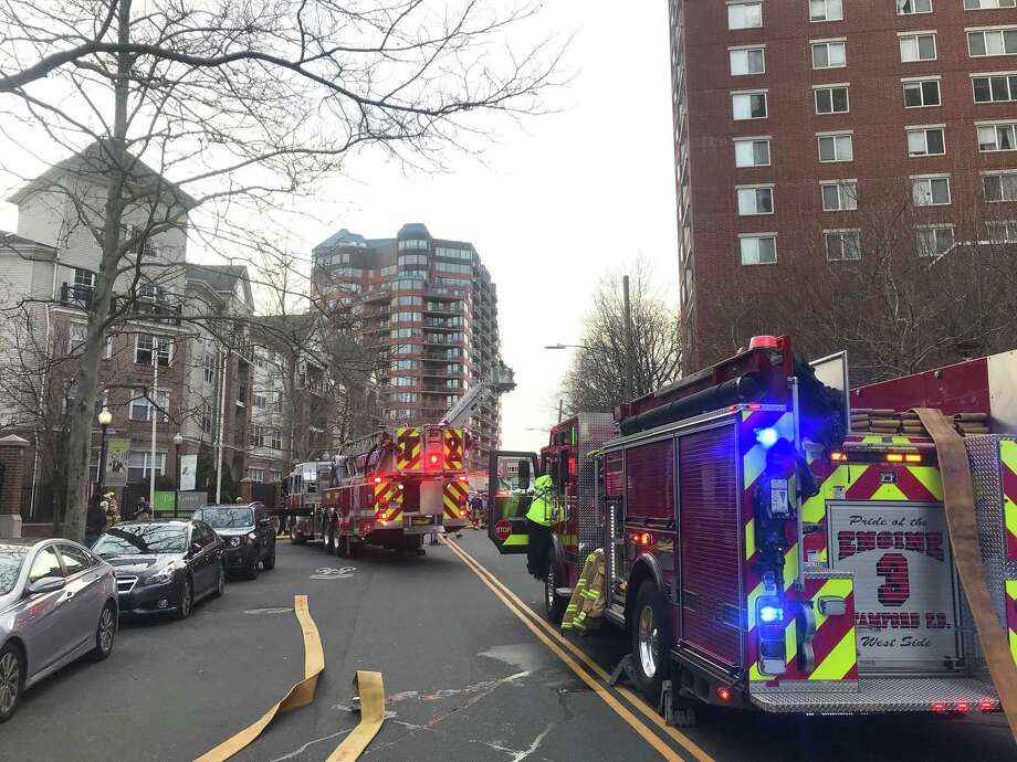 Stamford firefighters responded Monday to a fire at the Parc Grove Apartments in downtown Stamford. Photo: John Nickerson / Staff Photo