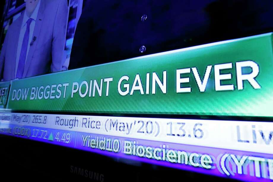 A television screen on the floor of the New York Stock Exchange headlines market activity, Monday, March 2, 2020. The Dow Jones Industrial Average surged more than 1,200 points, or 5%, on hopes that central banks will take action to shelter the global economy from the effects of the coronavirus outbreak. (AP Photo/Richard Drew) Photo: Richard Drew / Associated Press / Copyright 2019 The Associated Press. All rights reserved