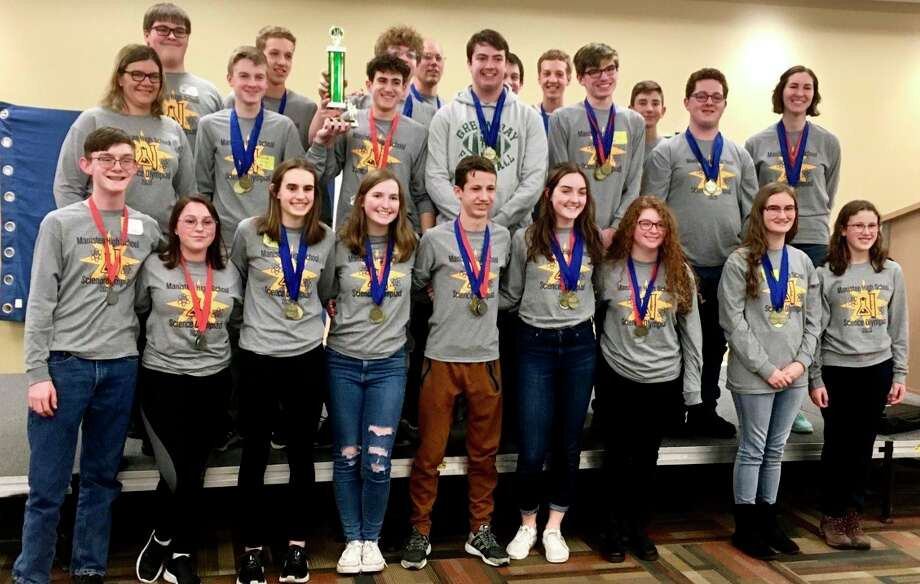 The Manistee High School Science Olympiad team proudly poses with their medals and trophy after winning the Regional competition. The team will now move on to the state finals on April 25 at Michigan State University in East Lansing. (Courtesy photo)