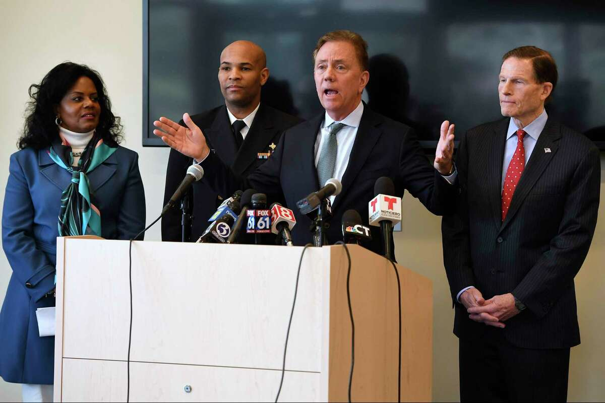 In March, as the coronavirus pandemic was getting a toehold in the state, Gov. Ned Lamont, center, spoke to reporters as Public Health Commissioner Renée D. Coleman-Mitchell, left, U.S. Surgeon General Vice Admiral Jerome M. Adams, second from left, and U.S. Sen. Richard Blumenthal, D-Conn., right, listened, at the Connecticut State Public Health Laboratory in Rocky Hill. Lamont announced Tuesday that he fired Coleman-Mitchell about a year after she was appointed to the job.
