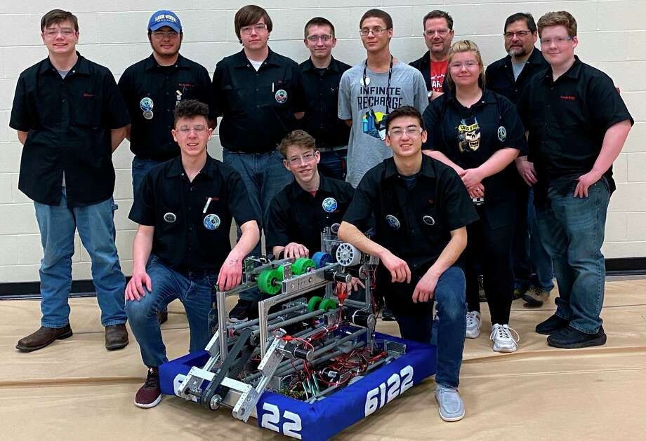 The Bear Lake Robotics team is shown with their robot that they competed with at Traverse City. Shown kneeling (left to right) areTrevor Eisenlohr, Marcus Langeland, and Tai Babinec. Back row (left to right) areJackson Salingue, Chris Gomez, Edward Fairchild, Kyle Fink, TJ Freeman, John Prokes, Megan Gydesen, Steve Gomez and Bryce Tracy. Not pictures isnot pictured was D.J. Swanson. (Courtesy photo)