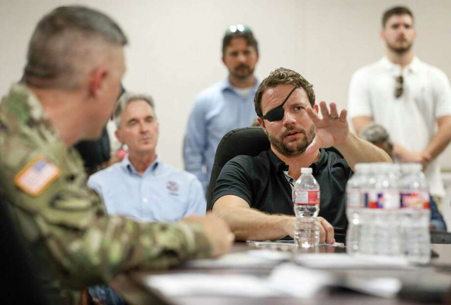 U.S. Rep. Dan Crenshaw asks questions during a briefing about the Addicks and Barker Reservoirs on Friday, Aug. 16, 2019, in Houston. Photo: Jon Shapley, Houston Chronicle / Staff Photographer / © 2019 Houston Chronicle