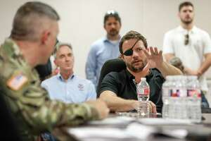 U.S. Rep. Dan Crenshaw asks questions during a briefing about the Addicks and Barker Reservoirs on Friday, Aug. 16, 2019, in Houston.