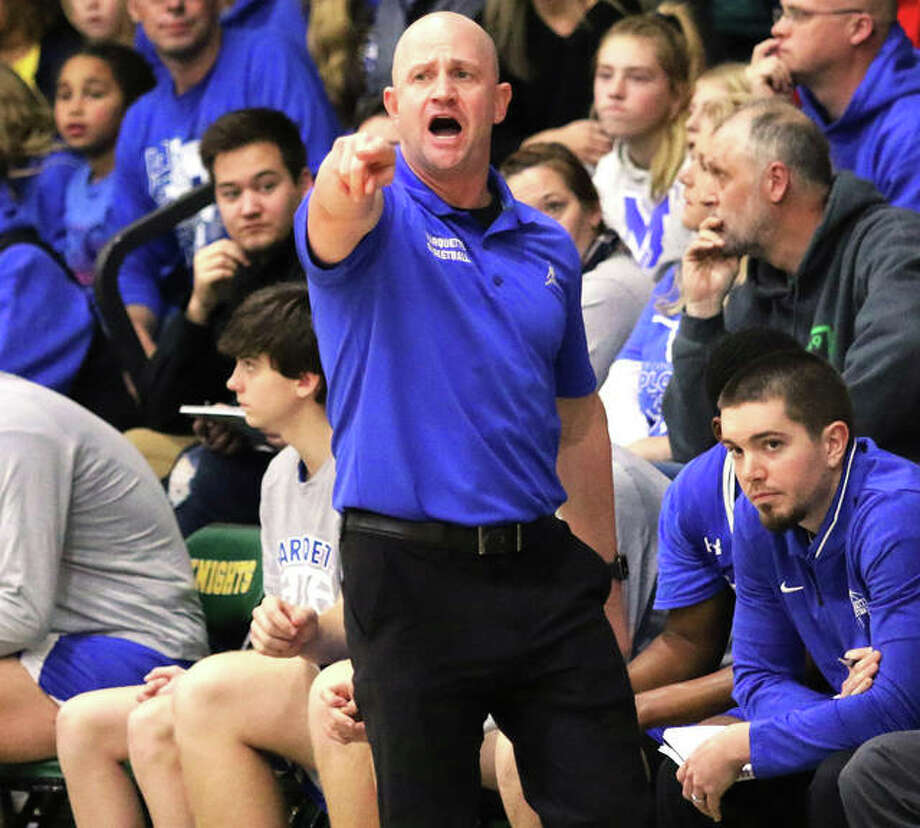 Marquette Catholic coach Steve Medford's Explorers will be in Shelbyville on Tuesday night to play Marshall in a Class 2A Sectional semifinal. Photo: Greg Shashack / The Telegraph