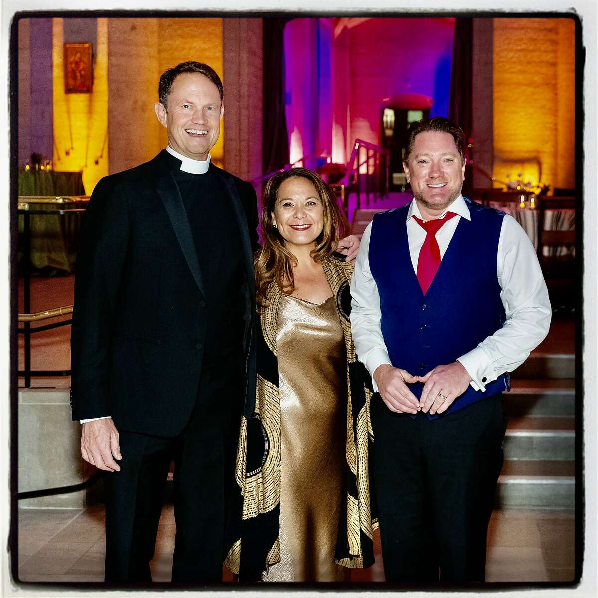 Grace Cathedral Dean Malcolm Clemens Young (left) with his wife Heidi Ho and Liam Mayclem at Carnivale. Feb. 25, 2020
