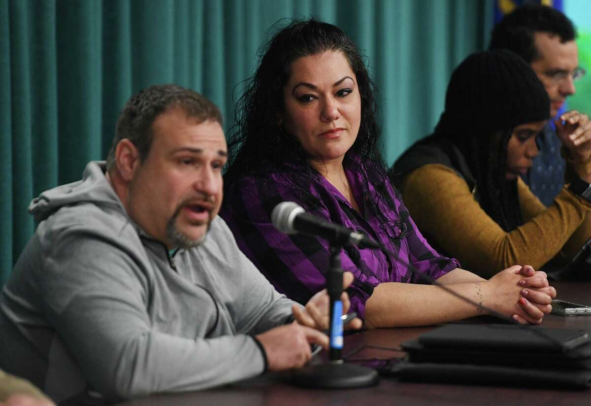 Bridgeport Board of Education Chair Jessica Martinez listens as fellow board member Hernan Illingworth speaks during a special meeting of the board in Bridgeport on Monday, March 2, 2020.