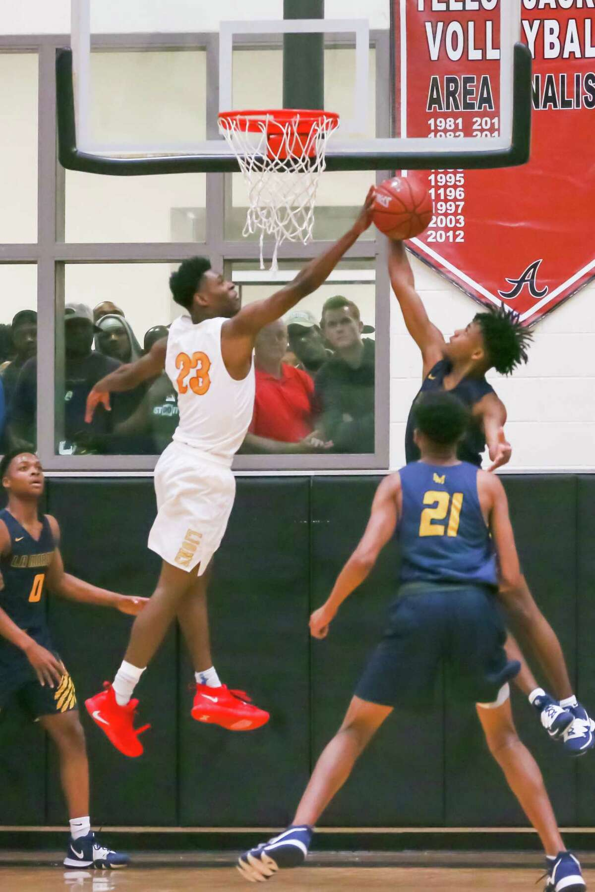 La Marque Keelan Norris (3) attempts to block a shot by Yates Latrell Moore (23) in the first quarter of the La Marque vs Yates boys' basketball Regional Quarter Final game on at Alvin High School Field House on March 2, 2020 in Alvin, TX.