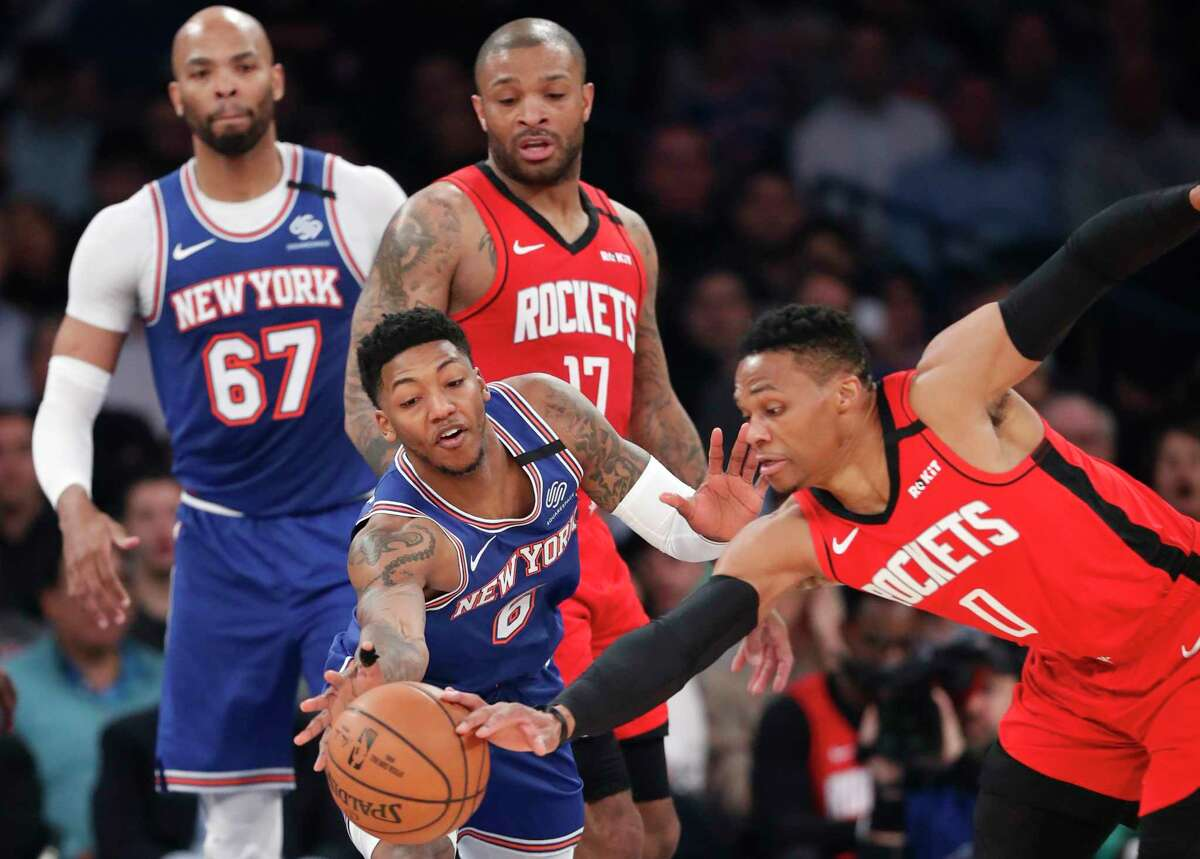 New York Knicks guard Elfrid Payton (6) and Houston Rockets guard Russell Westbrook (0) go after the ball as Knicks center Taj Gibson (67) and Rockets forward P.J. Tucker (17) watch during the second quarter of an NBA basketball game in New York, Monday, March 2, 2020. (AP Photo/Kathy Willens)