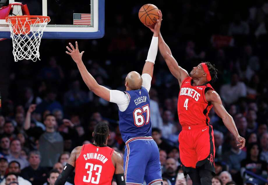 Houston Rockets forward Danuel House Jr. (4) gets his hand on the ball as New York Knicks center Taj Gibson (67) prepares to shoot during the second quarter of an NBA basketball game in New York, Monday, March 2, 2020. (AP Photo/Kathy Willens) Photo: Kathy Willens, Associated Press / Copyright 2020 The Associated Press. All rights reserved.