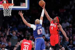 Houston Rockets forward Danuel House Jr. (4) gets his hand on the ball as New York Knicks center Taj Gibson (67) prepares to shoot during the second quarter of an NBA basketball game in New York, Monday, March 2, 2020. (AP Photo/Kathy Willens)