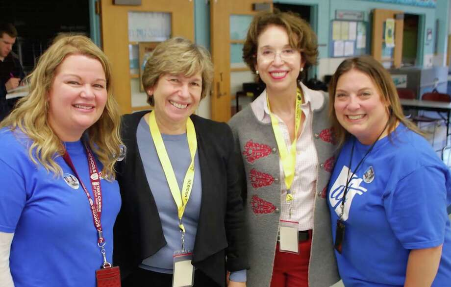 Barbara Dalio, director of Dalio Education Initiatives, part of Dalio Philanthropies, is speaking around the state about the Partnership for Connecticut program that she co-founded. Dalio (in glasses) shown with Randi Weingarten, national president of the American Federation of Teachers, at the John Barry Elementary School in Meriden, in November, 2018, flanked by two teachers from the school. Photo: Courtesy Of Dalio Education Initiatives /