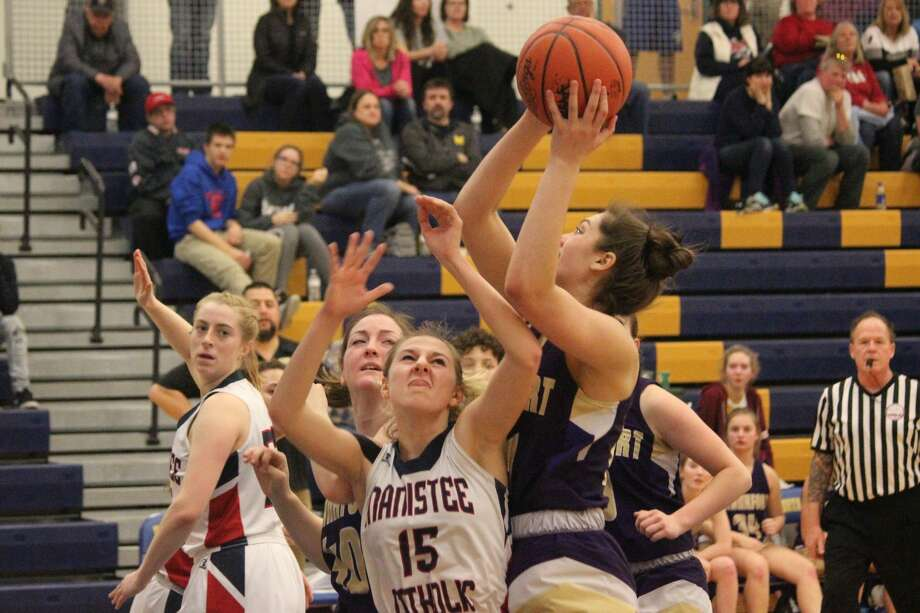 Abby Hodge goes back up with the ball after collecting an offensive rebound. Photo: Robert Myers