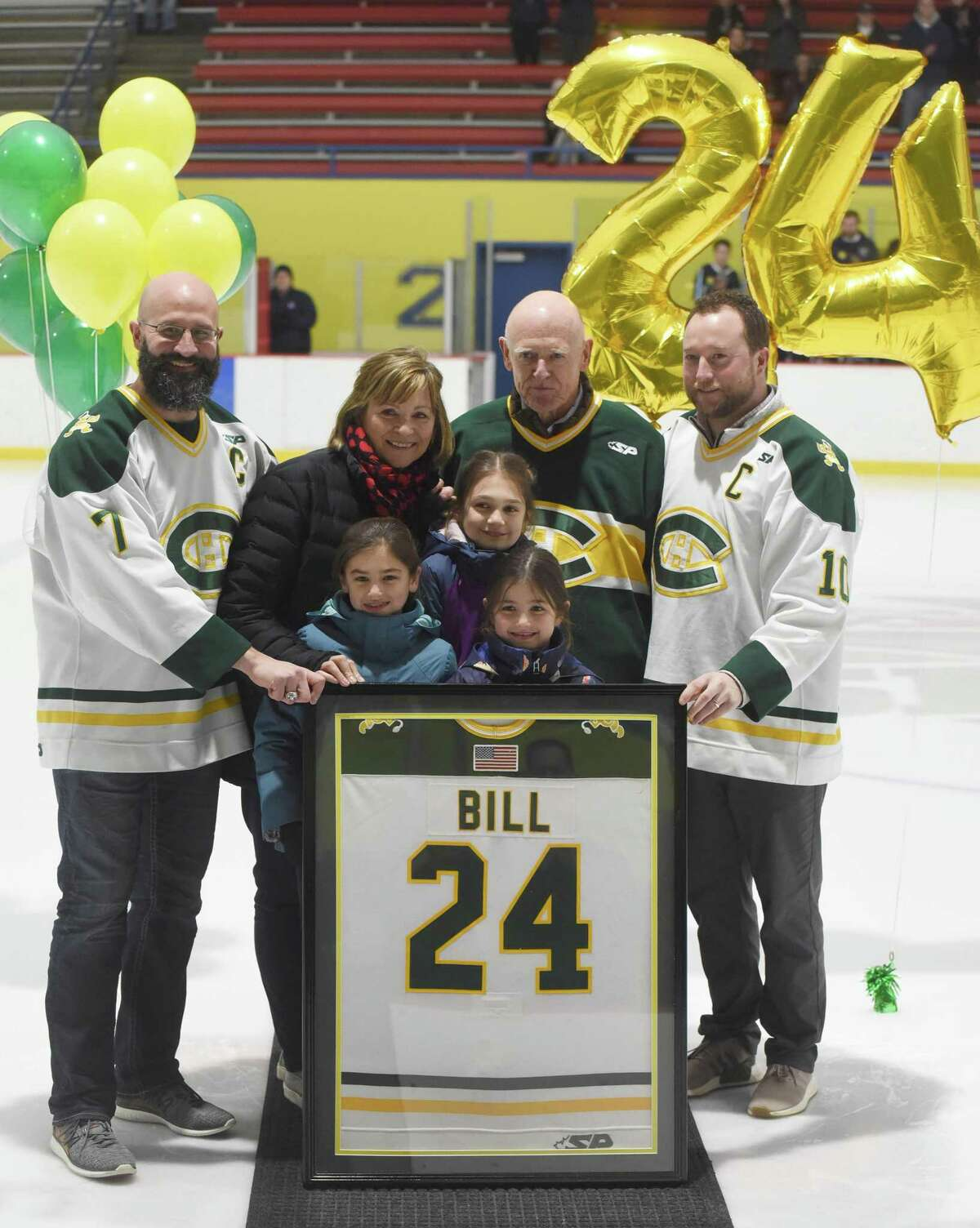 Former Trinity Catholic ice hockey players John Scofield (7) and Jimmie Bruno (10) present Brian Bill's retired jersey No. 24 to his parents, Pat Parry and Dr. Michael Parry, and nieces Ryder, Emma, and Everest Kutney, during a ceremony at Terry Conners Rink on Monday, March 2, 2020. Bill, a 1997 graduate of TCHS and a Navy SEAL, died in Afghanistan on Aug. 6, 2011.