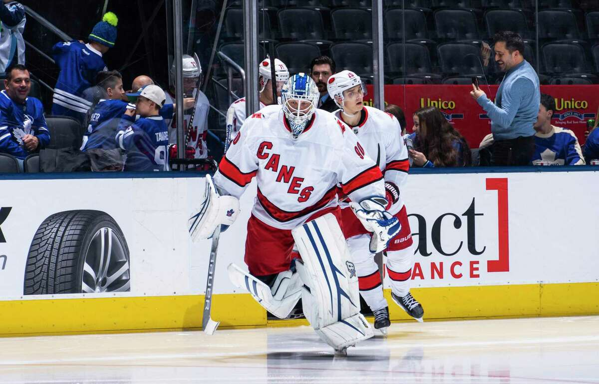 After both Carolina goalies were injured in the game, David Ayres took over in the net and stopped eight of 10 shots as the Hurricanes beat the Maple Leafs.