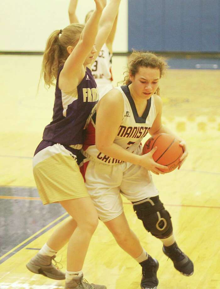 Manistee Catholic Central's Leah Stickney is guarded by a Frankfort defender during the Sabers' district loss in Onekama on Monday. (Kyle Kotecki/News Advocate)