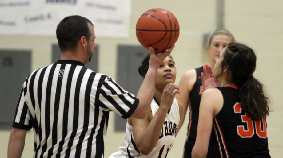 The Cass City girls basketball team pulled of a thrilling upset over Harbor Beach in the first round of districts, winning by a score of 46-34 on Monday night. Photo: Eric Rutter/Huron Daily Tribune