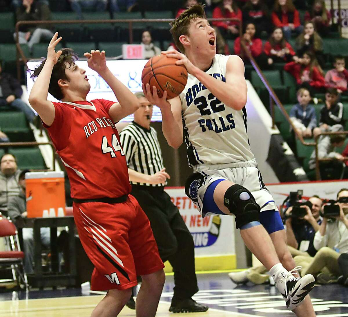 Hoosick Falls' Tristan Williams drives to the basket past Mechanicville's Devin Garland during a Class B semifinal game at the Cool Insuring Arena on Monday, March 2, 2020 in Glens Falls, N.Y. (Lori Van Buren/Times Union)