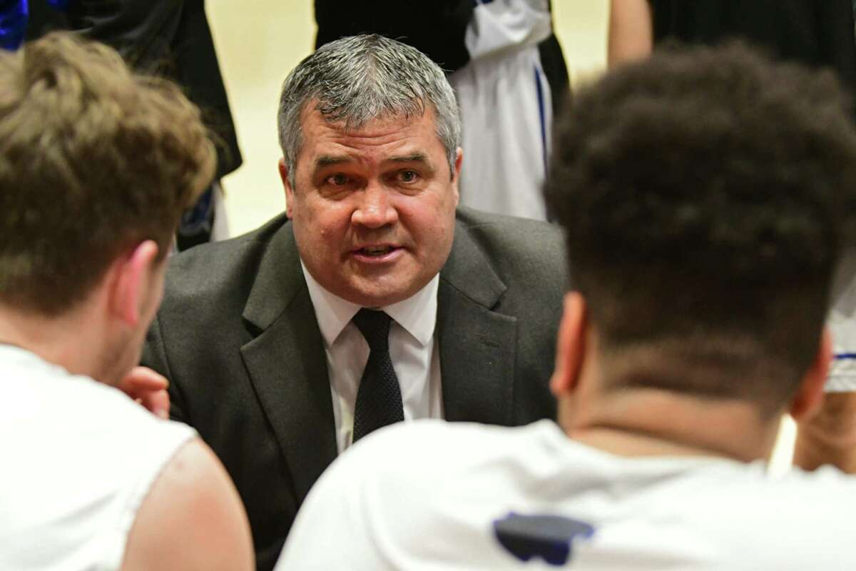 Hoosick Falls boys' basketball coach Mike Lilac said he has been acting more like a counselor than a coach as he's watched his team go through the roller coaster of emotions as, at first, it seemed like the season might start, then was called off by the school.(Lori Van Buren/Times Union)