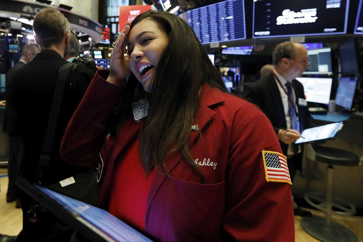 Trader Ashley Lara works on the floor of the New York Stock Exchange, Friday, Feb. 28, 2020. Stocks are opening sharply lower on Wall Street, putting the market on track for its worst week since October 2008 during the global financial crisis. (AP Photo/Richard Drew)