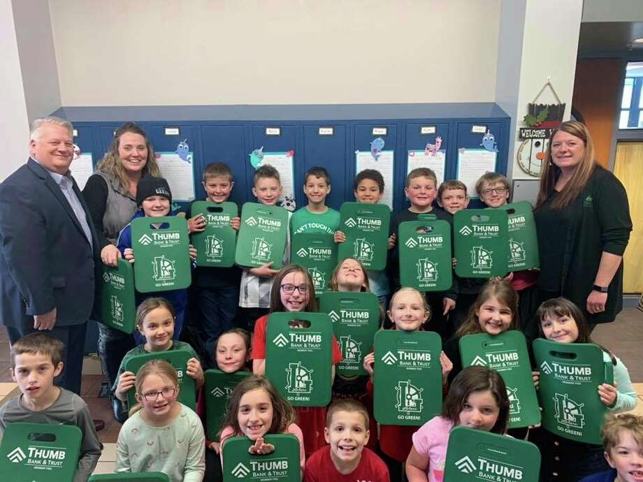 After receiving a request from Laker Elementary Teacher Mrs. Smithers, Thumb Bank and Trust provided 300 cushions to make classroom work more comfortable. (Courtesy Photo)