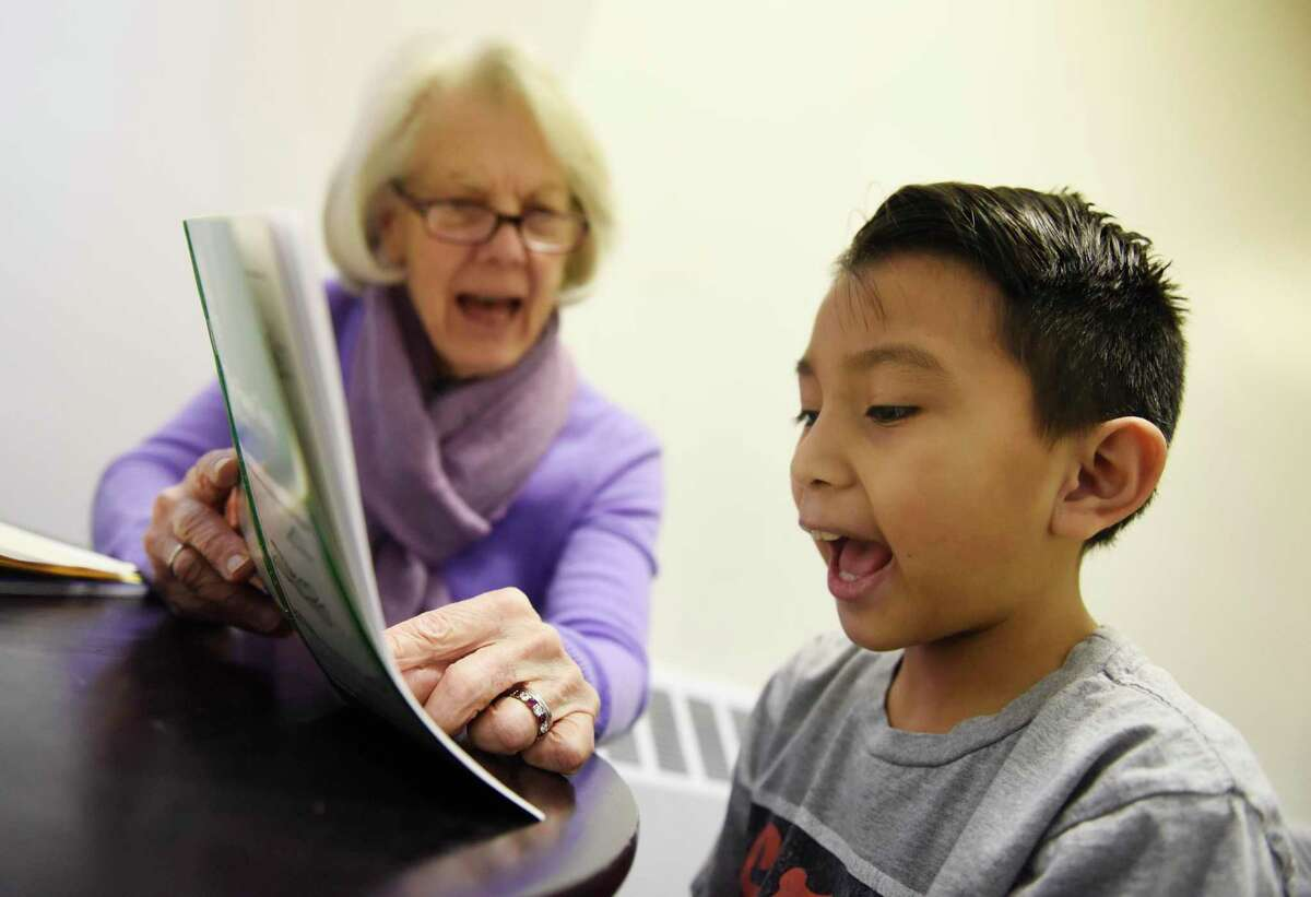 Volunteer Pat Young tutors Greenwich's Charles Cajas, 8, at Family Centers' Family First in Education program at the YMCA Early Learning Center in the Chickahominy section of Greenwich, Conn. Tuesday, Jan. 29, 2019. It is one of the many prorgrams run by Family Centers.