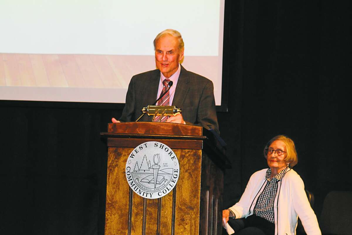 Bill Paine speaks at a Manistee Commitment Scholarship induction ceremony. Along with wife Marty, Paine was a committed philanthropist and benefactor for several local institutions.