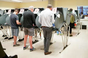 Voters line up to cast their ballots, Tuesday, March 3, 2020, at the West Gray Metropolitan Multi-Service Center.
