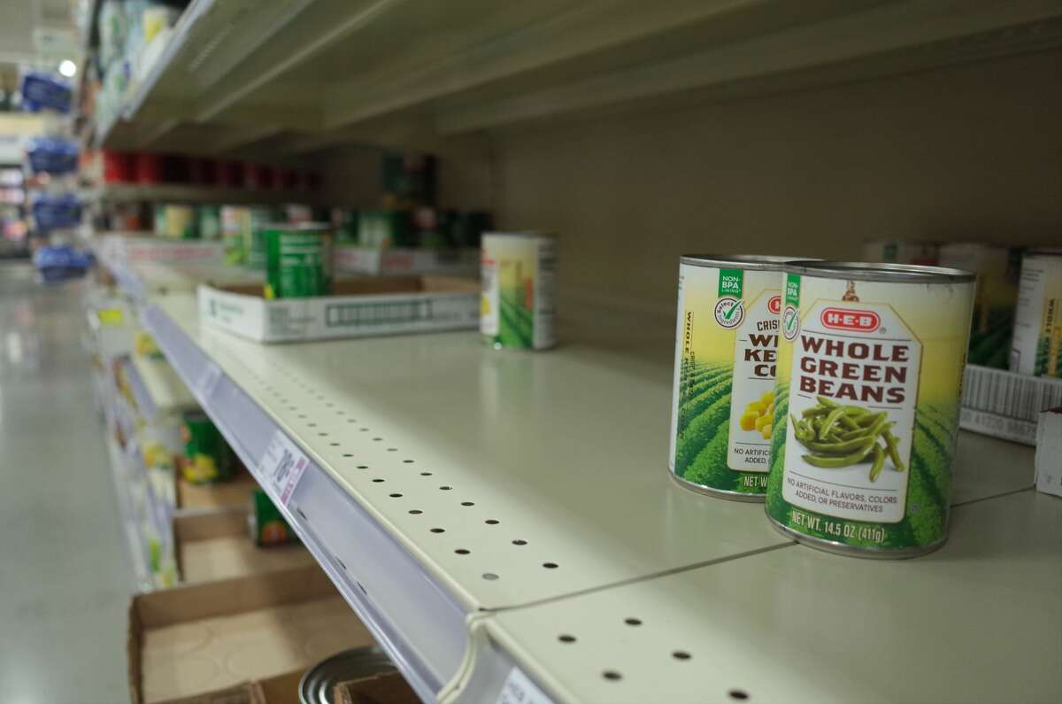 The shelves of canned goods were picked over at a H-E-B in Cypress on Monday, March 2, 2020, as consumers rushed to buy household staples amid rising cases of the coronavirus.