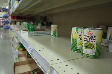 The shelves of canned goods were picked over at a H-E-B in Cypress on Monday, March 2, 2020.