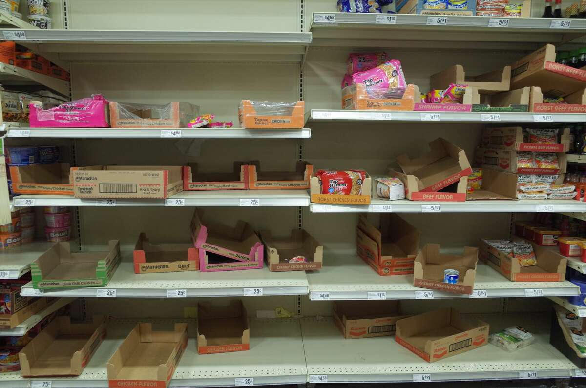 The shelves of instant ramen noodles were empty at a H-E-B in Cypress on Monday, March 2, 2020, as consumers rushed to buy household staples amid rising cases of the coronavirus.