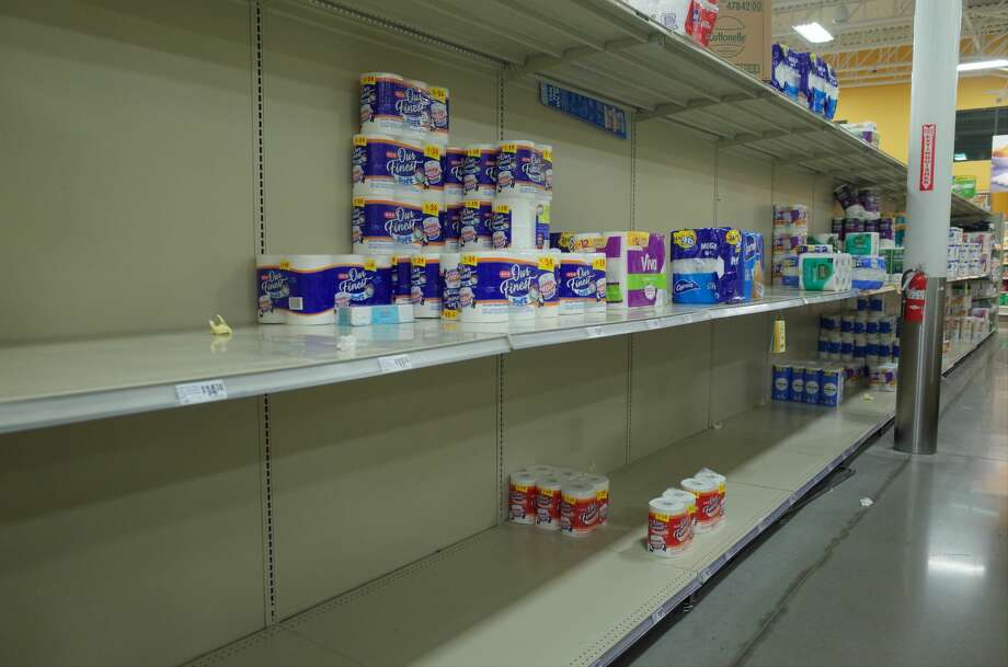 The aisle of toilet paper and paper towels were nearly empty at a H-E-B in Cypress on Monday, March 2, 2020, as consumers rushed to buy household staples. H-E-B has reinstated purchasing limits on toilet paper as coronavirus cases rise throughout Texas. Photo: Paul Takahashi