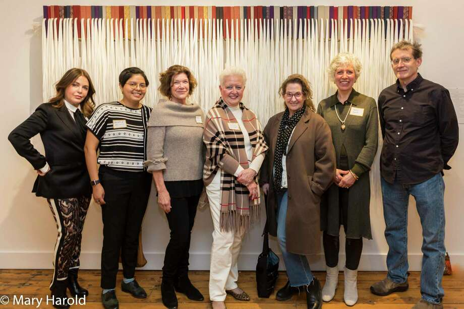 Exhibiting artists Sonia Bombart, Angela Miskis, Connie Brown, Kathleen Wrampe, Sharon Butler (juror), Karen Kent, and Chris Perry at Ridgefield Guild of Artists' 2-1-2 juried exhibition in front of one of Chris Perry's pieces. Photo: Mary Harold / Copyright 2015  Mary Harold