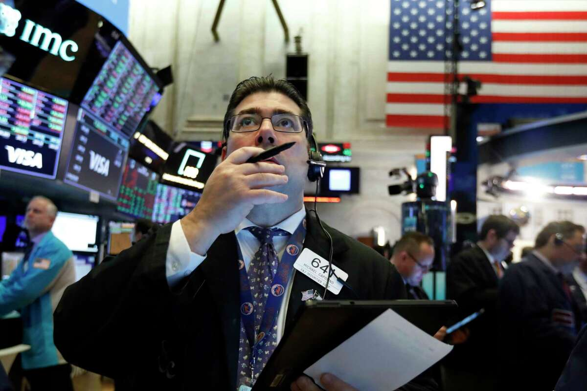 Trader Michael Capolino works on the floor of the New York Stock Exchange, Tuesday, March 3, 2020. Stocks are opening lower on Wall Street after the Group of Seven countries held off on giving the global economy new stimulus to help it cope with the coronavirus outbreak.