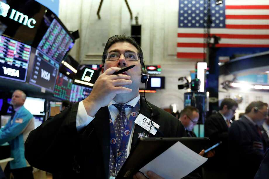 Trader Michael Capolino works on the floor of the New York Stock Exchange, Tuesday, March 3, 2020. Stocks are opening lower on Wall Street after the Group of Seven countries held off on giving the global economy new stimulus to help it cope with the coronavirus outbreak. Photo: Richard Drew, AP / Copyright 2019 The Associated Press. All rights reserved
